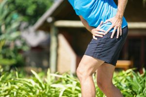 A male person, having severe hip pain